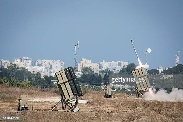 The Iron Dome air-defense system fires to intercept a rocket over the city of Ashdod on July 8 in Ashdod, Israel. Due to recent escalation in the...