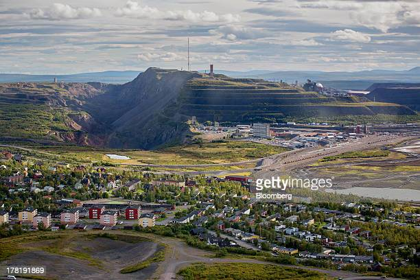 The iron ore mine operated by LKAB Sweden's stateowned mining company stands beyond residential housing in Kiruna Sweden on Wednesday Aug 21 2013...