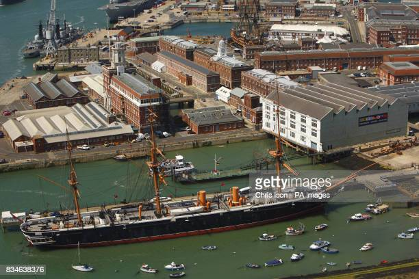 The iron warship HMS Warrior and the historic dockyard as seen from the top of the Spinnaker Tower in Portsmouth Hampshire
