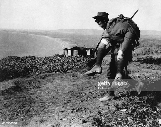The irrepressible Australians at Anzac An Australian bringing in a wounded comrade to hospital Dardanelles Campaign ca 1915 | Location Gallipoli...