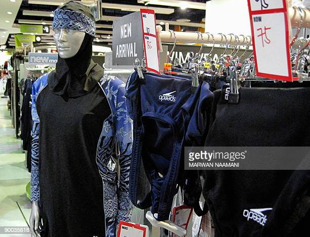 The Islamic fulllength swimming suit known as Burqini is displayed on a mannequin at a sports store in Dubai on August 23 2009 The threepiece lycra...