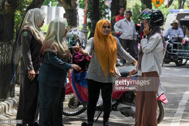 LHOKSEUMAWE ACEH INDONESIA The Islamic Sharia Police officers Wilayatul Hisbah are seen stopping a motorists wearing tight clothes during the routine...