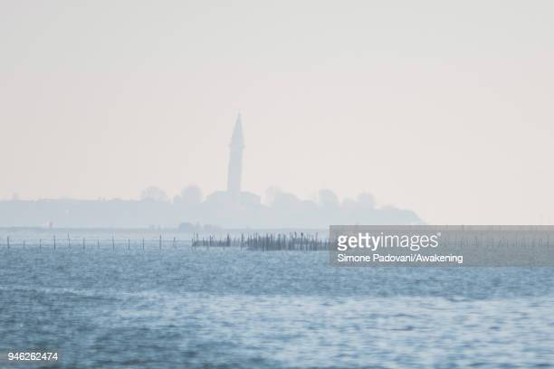 The island of Burano is seen before a tour of fishing tourism organized by Cooperativa San Marco in Burano on April 14 2018 in Venice Italy At the...
