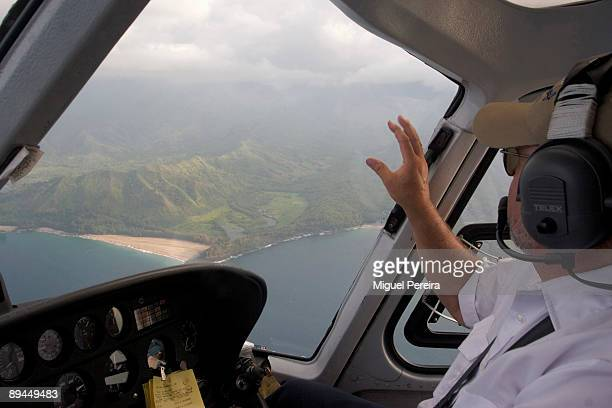 The Island of Kauai seen from the shuttle helicopter The most popular of activities and vacation tours for visitors to Kauai Hawaii are the...