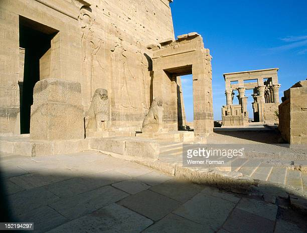 The Island of Philae View of the gate to the temple of Isis build by Ptolemy II Philadelphus In the background is the kiosk of Trajan Egypt Ancient...