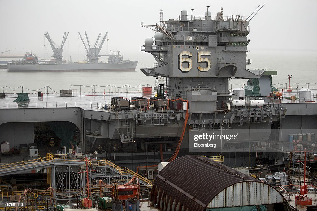 The island tower of the USS Enterprise (CVN 65) aircraft carrier is seen from the USS Gerald R. Ford (CVN 78) aircraft carrier during outfitting and testing at Huntington Ingalls Industries' Newport News Shipbuilding shipyard in Newport News, Virginia, U.S., on Monday, April 28, 2014. Huntington Ingalls Industries Inc. is expected to release earnings figures on May 8. Photographer: Andrew Harrer/Bloomberg via Getty Images