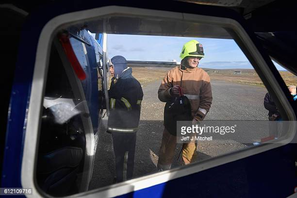 The Islander Aircraft is loaded with bags at the airstrip on the Island of Foula on October 3 2016 in Foula Scotland Foula is the remotest inhabited...