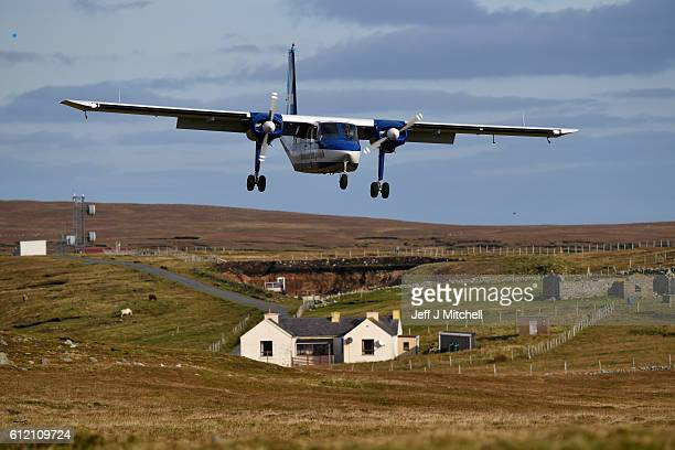 The Islander Aircraft land at the airstrip on the Island of Foula on October 3 2016 in Foula Scotland Foula is the remotest inhabited island in Great...