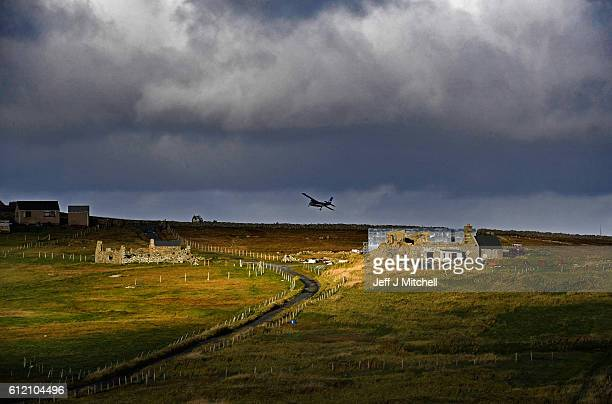 The Islander Aircraft takes off from the airstrip on the Island of Foula heading for Tingwall on September 30 2016 in Foula Scotland Foula is the...