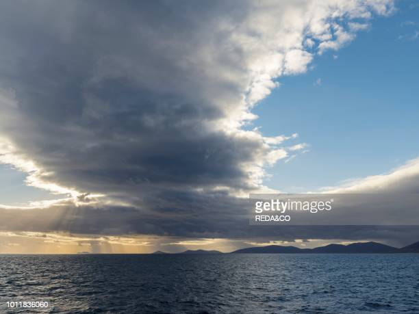 The islands of the West Falklands seen from the sea with dramatic clouds Saunders Island Keppel Island and Pebble Island South America Falkland...