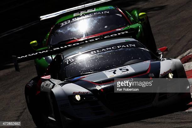 The ISR Audi R8 LMS Ultra of Marco Bonanomi and Filip Salaquadra leads from the Rinaldi Racing Ferrari 458 Italia of Marco Seefried and Norbert...