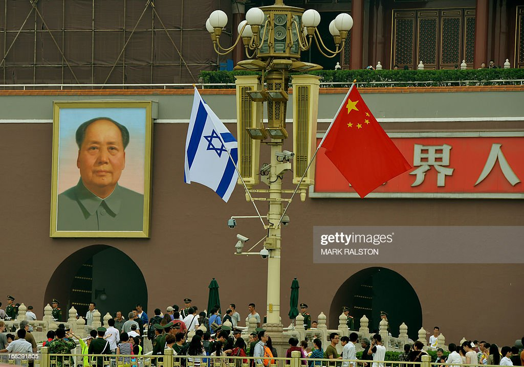 The Israeli and Chinese flags fly beside the portrait of Mao Zedong at Tiananmen Gate in Beijing on May 8, 2013. Israeli Prime Minister Benjamin Netanyahu is on a five day visit to China and will meet with Chinese President Xi Jinping and other top officials. AFP PHOTO/Mark RALSTON
