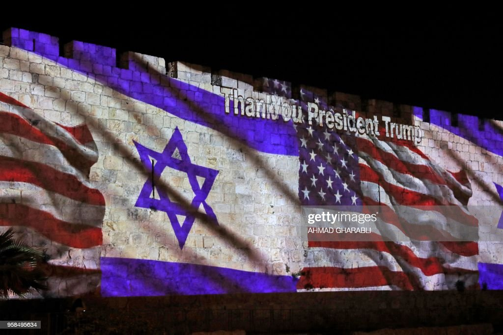 TOPSHOT - The Israeli and United States flags are projected on the walls of the ramparts of Jerusalem's Old City, to mark the opening of the new US embassy on May 14, 2018. - The United States moved its embassy in Israel to Jerusalem after months of global outcry, Palestinian anger and exuberant praise from Israelis over President Donald Trump's decision tossing aside decades of precedent.