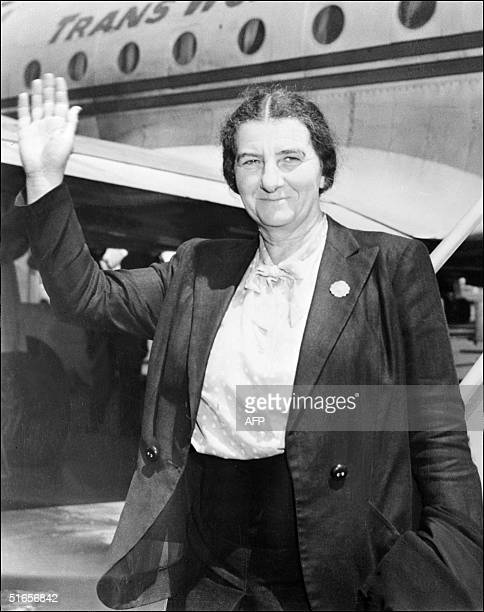The Israeli deputy Foreign minister Golda Meir waves to the press 26 May 1948 upon her landing at New York airport prior to attend the United Jewish...