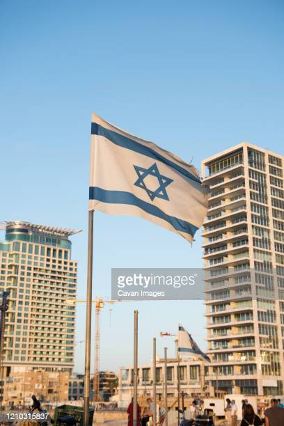 the israeli flag flies in a warm summer breeze - tel aviv stock pictures, royalty-free photos & images