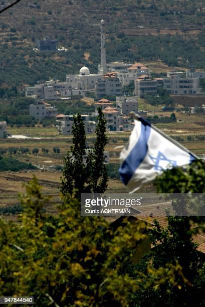 The Israeli flag flies over the West Bank settlement of historic Shilo marked by the red roof homes Shilo is a large West Bank settlement located...