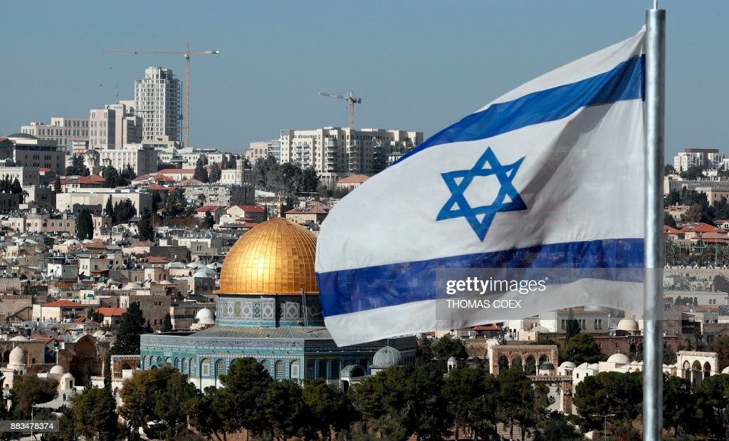 The Israeli flag flutters in front of the Dome of the Rock mosque and th city of Jerusalem, on December 1, 2017. US President Donald Trump may recognize Jerusalem as the capital of Israel. The international community says Jerusalem's status must be negotiated between Israelis and Palestinians. Israel occupied east Jerusalem in the 1967 Six-Day War and later annexed it in a move never recognised by the international community. COEX