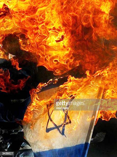 The Israeli flag is burned by Palestinian militants during an antiIsrael rally on April 17 in Gaza Gaza Strip Thousands of palestinians attended...