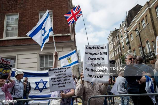 The Israeli flag seen at the prozionist counterdemo Hundreds of antiIsrael protesters marched through the streets on the annual Al Quds Day Started...