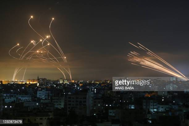 The Israeli Iron Dome missile defence system intercepts rockets fired by the Hamas movement towards southern Israel from Beit Lahia in the northern...