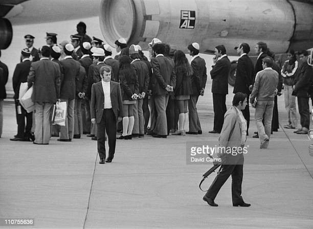 The Israeli Olympic team board an El Al flight at MunichRiem Airport after the death of 11 of their number at the hands of Palestinian terrorist...