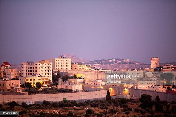 The Israeli separation barrier is seen as as it surrounds the tomb of the biblical Matriarch Rachel on July 13 2011 in the West Bank town of...