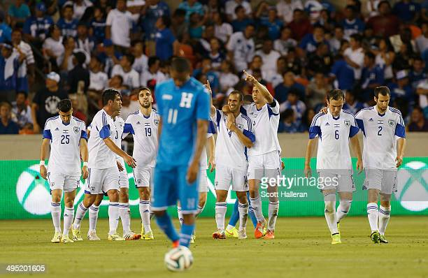 The Isreal team celebrates a second half goal as Jerry Bengtson of Honduras waits at midfield during their Road to Brazil match at BBVA Compass...