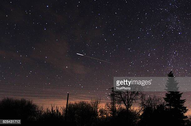 The ISS is seen over the night sky during the Gemenids meteor shower in the observatory of Avren East of the Bulgarian capital Sofia Dec14 2015 The...