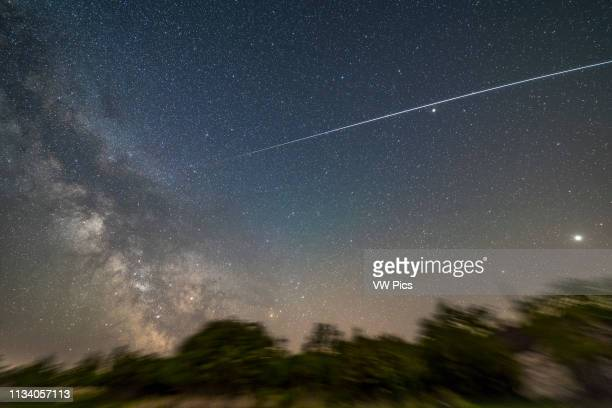 The ISS passes into shadow on a pass at about 1:30 am on the morning of May 30, 2017 traveling from west right to southeast left The trail dims as it...