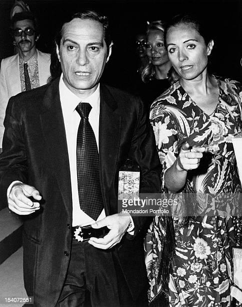 The Italian actor and director Nino Manfredi walking with his wife the Italian model Erminia Ferrari Taormina 1972