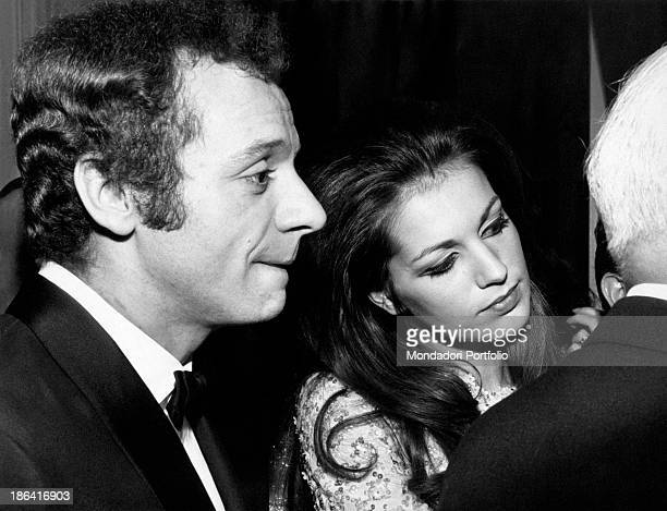 The Italian actor and singer Johnny Dorelli next to the French actress and singer Catherine Spaak in the background of the Sanremo Music Festival;...