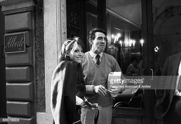The Italian actor comician and TV host Walter Chiari and the singer and actress Alida Chelli his future wife walking along the streets of the...
