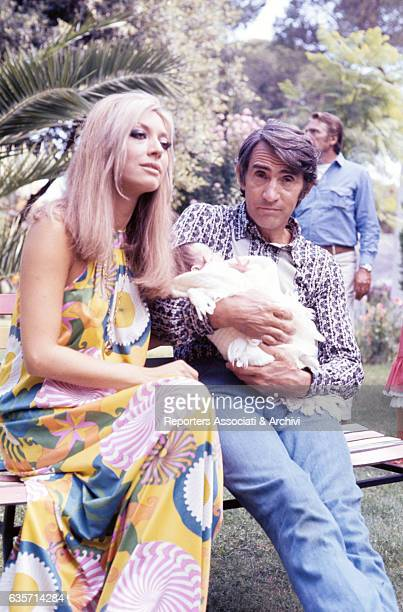 The Italian actor comician and TV host Walter Chiari holding in the arms his son Simone who was born in 1970 Seated next to him the wife Alida Chelli...