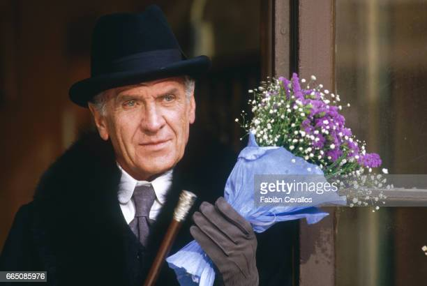 The Italian actor Massimo Girotti holds a flower bouquet during the shooting of the musical La Boheme based on Italian composer Giacomo Puccini's...