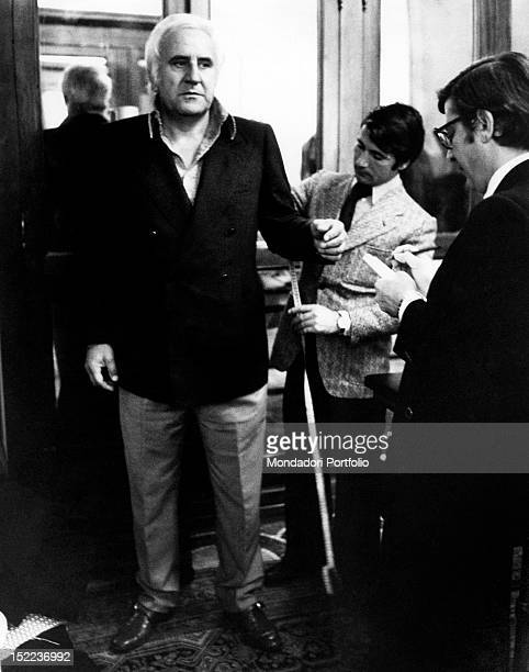 The italian actor scriptwriter and director Adolfo Celi getting measured by a tailor Rome 1970s