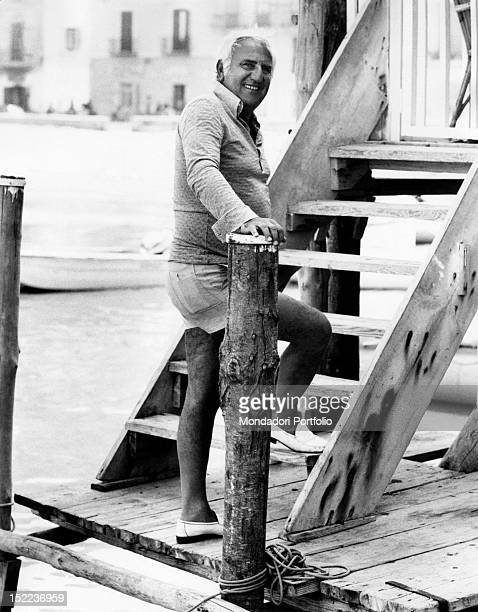 The italian actor scriptwriter and director Adolfo Celi getting ready to go up the stairs Ponza 1970s