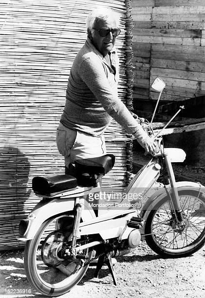 The Italian actor scriptwriter and director Adolfo Celi leaning on the handlebars of a moped Ponza 1970s