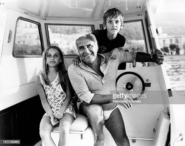 The italian actor scriptwriter and director Adolfo Celi sitting in a motorboat with his children Leonardo and Alessandra Ponza 1970s