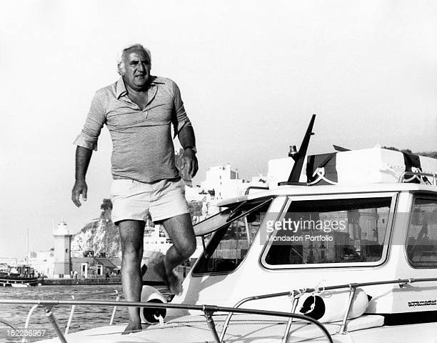 The italian actor scriptwriter and director Adolfo Celi walking on the bow of a motorboat Ponza 1970s