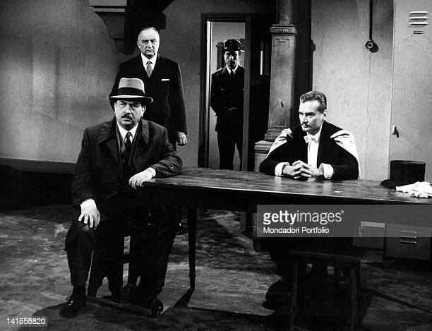 The Italian actors Gino Cervi Francesco Sormano and Franco Volpi playing in the tv serial 'Il commissario Maigret Una vita in gioco' Italy 1965