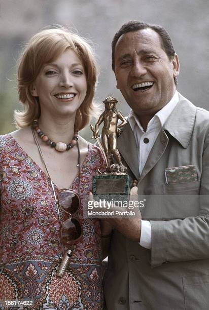 The Italian actors Mariangela Melato and Alberto Sordi posing smiling with David di Donatello award Both have respectively won as best actress in...