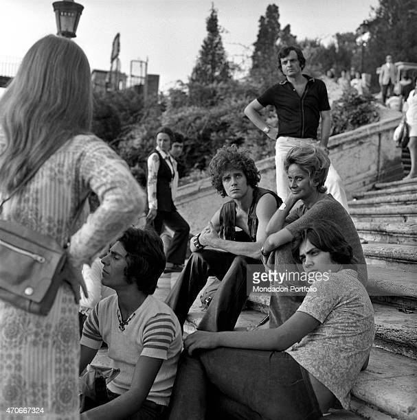 'The Italian actress Alida Valli born Alida Maria von Altenburger von Markenstein und Frauenberg is seated on a flight of steps next to her son Carlo...