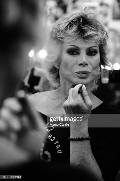 The italian actress and showgirl Carmen Russo in the dressing room while dressing up before a TV show