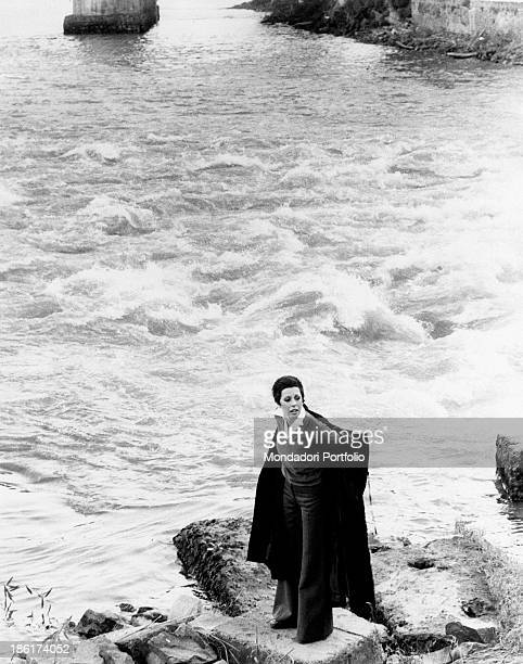 The Italian actress and singer Daniela Goggi dressing a dark coat by a bank of the Tiber river Daniela Goggi is the younger sister of the actress and...