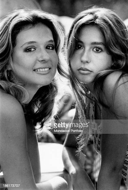 The Italian actress and singer Daniela Goggi is posing cheek to cheek with her older sister the singer actress and show girl Loretta this year they...