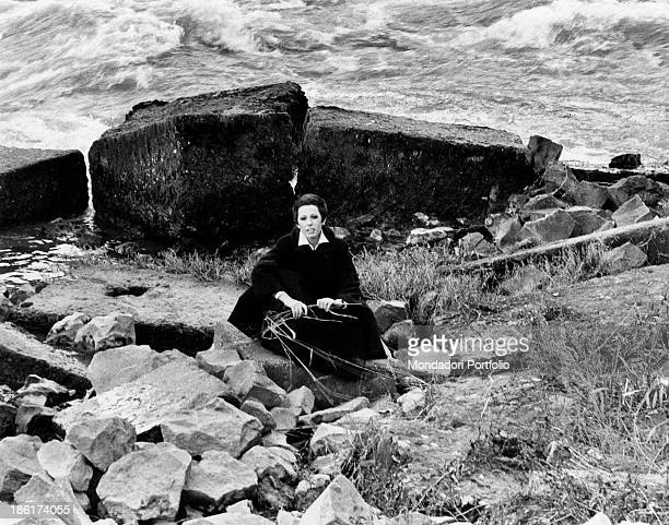 The Italian actress and singer Daniela Goggi is seated by a dock along the Tiber river Daniela Goggi is the younger sister of the actress and singer...