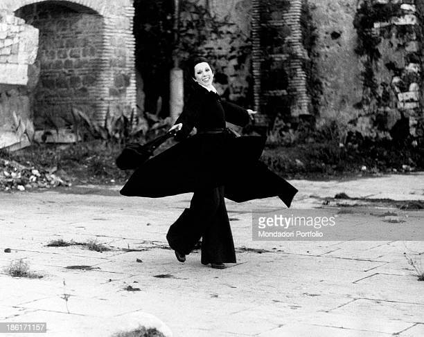The Italian actress and singer Daniela Goggi with radiant look is improvising a dance movement by doing a pirouette the artist has reached her peak...