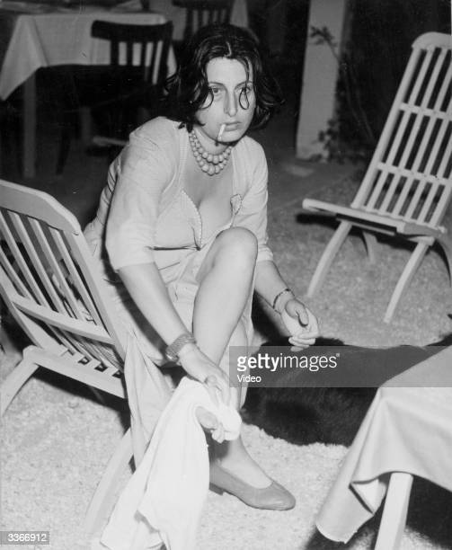 The Italian actress Anna Magnani at her apartment in Rome