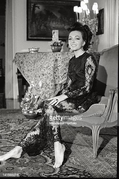 The Italian actress Bedy Moratti posing for a portrait at her home wearing a lace dress Milan May 1968