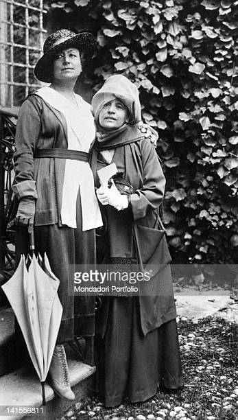 The Italian actress Eleonora Duse posing with French colleague Cecile Sorel in a garden 1916